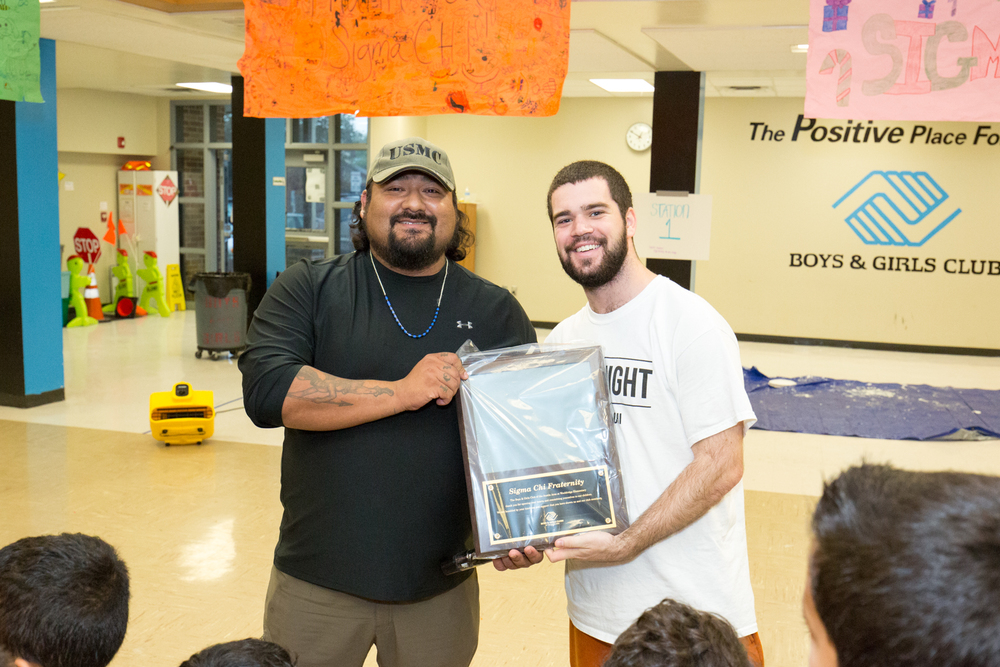 The Boys and Girls club at Wooldridge elementary school presented texas sigma chi with an award of thanks for their work with wooldridge students.