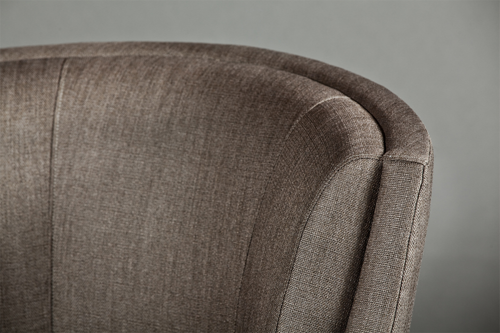 Attention to detail during  the upholstery process gives this chair a sophisticated tailored look.