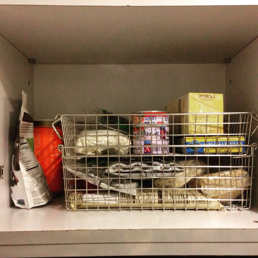 This weekend I stayed in and organized my kitchen. I wish I'd taken a before picture because this cupboard was a total disaster before I got real and put things in order.