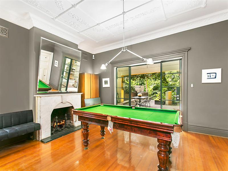 Spacious living areas provide for set ups of a pool table.
