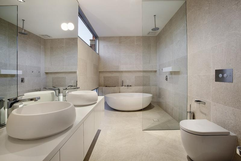 Design is a common theme inside this home, with the bathroom taking a very modern and stylish approach.