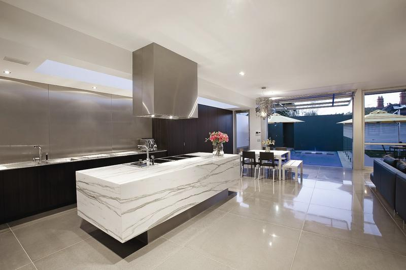 The kitchen features the most modern appliances, with a beautiful central island bench and an open living area.