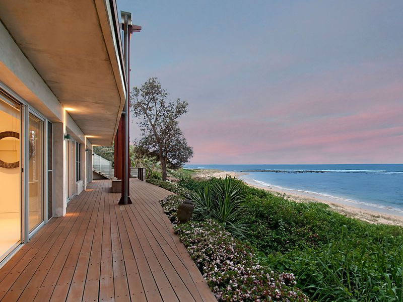 Beautiful blend from the exterior of the house down to the beach.