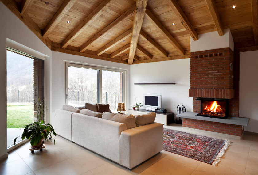 A fireplace makes a great central piece for a home, especially if it is understated.
