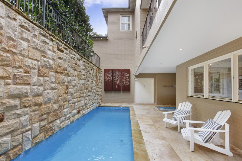 The fully tiled pool with spa by its side.