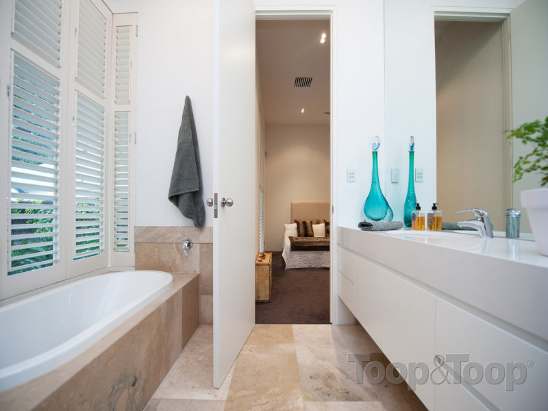 Beautifully designed bathroom and tiled interior screams luxury.
