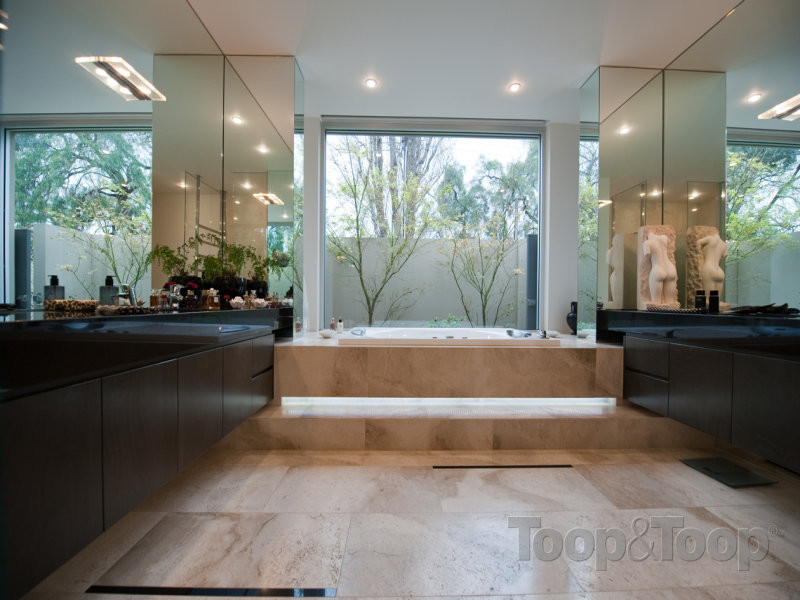 The view of the second bathroom, overlooking the beautiful garden lined surroundings.