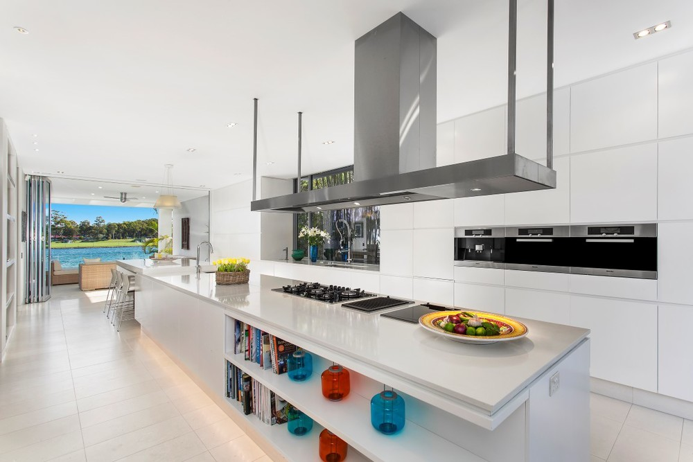 The kitchen has ultra modern appliances and has bifolding doors to open.