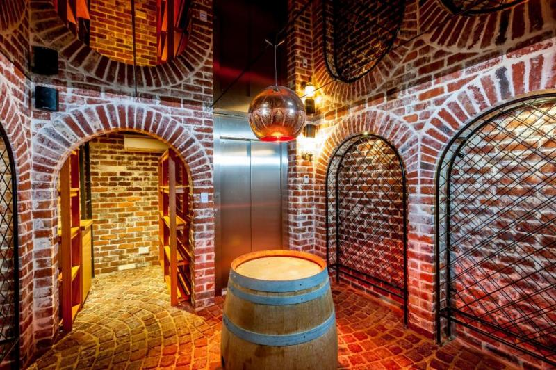 The wine cellar is exposed brick, iron detailing, cobblestone flooring and arches and is accessed via the lift.