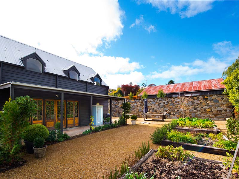 The beautiful exterior of this Daylesford house. An exceptional garden accompanies the home.