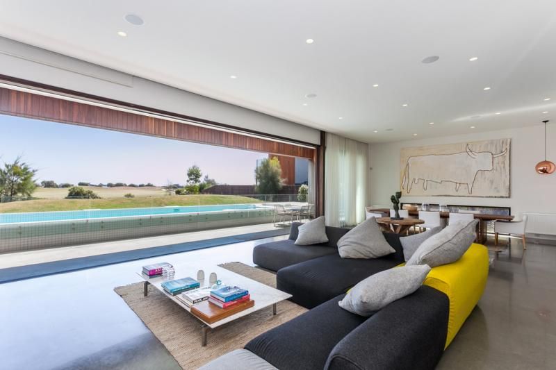 The open living room with views of the pool and outdoor areas.