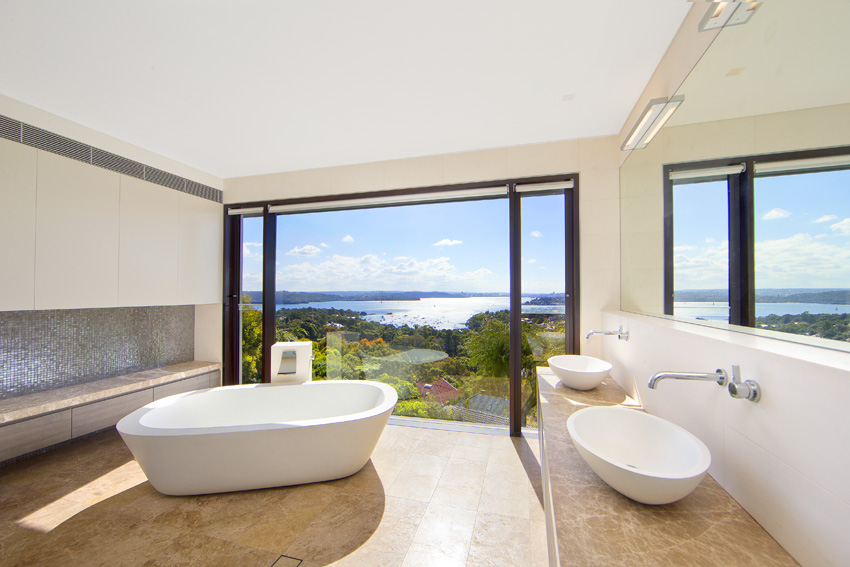 You can relax with sensational views of the water in this open bathroom.