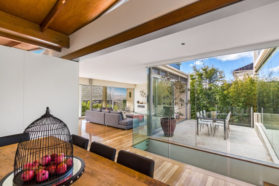 The glass walls ensure that natural light comes in to the home, which easily blends indoor and outdoor living.