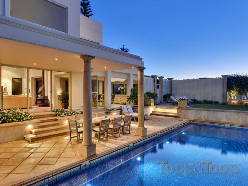 The outdoor area by the pool, which seamlessly connects to the living areas.