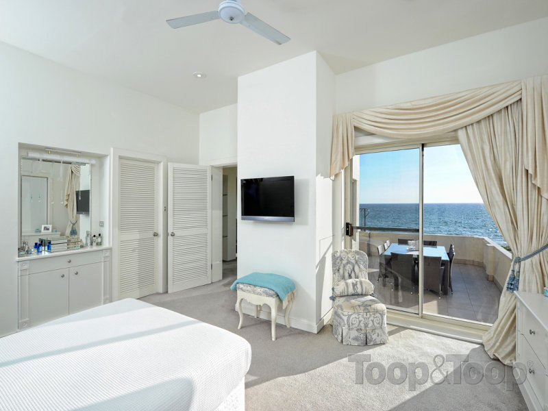The master bedroom with ocean views on offer and a private balcony.