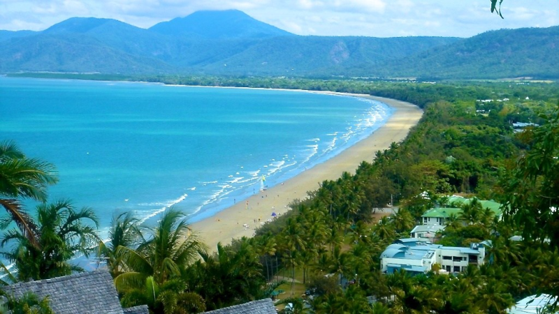 The gorgeous beach in Port Douglas brings an abundance of tourists.