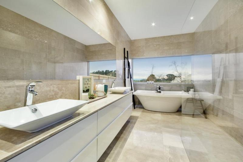 Gorgeous marble finishes inside the bathroom provide the best in luxury, with the bath rub providing endless ocean views.