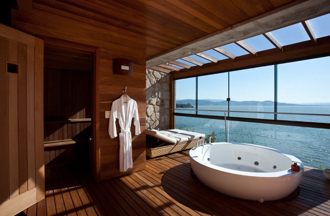 Situated on the edge of the Atlantic Ocean, this timber inspired bathroom comes with a sauna to warm up.