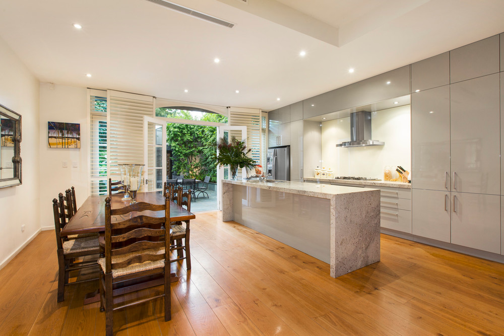 The kitchen space in this Toorak home has cleverly integrated design.