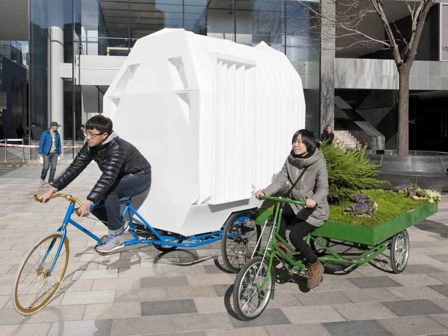 This totals 33sqft. home can be folded up and put on the back of a bike.