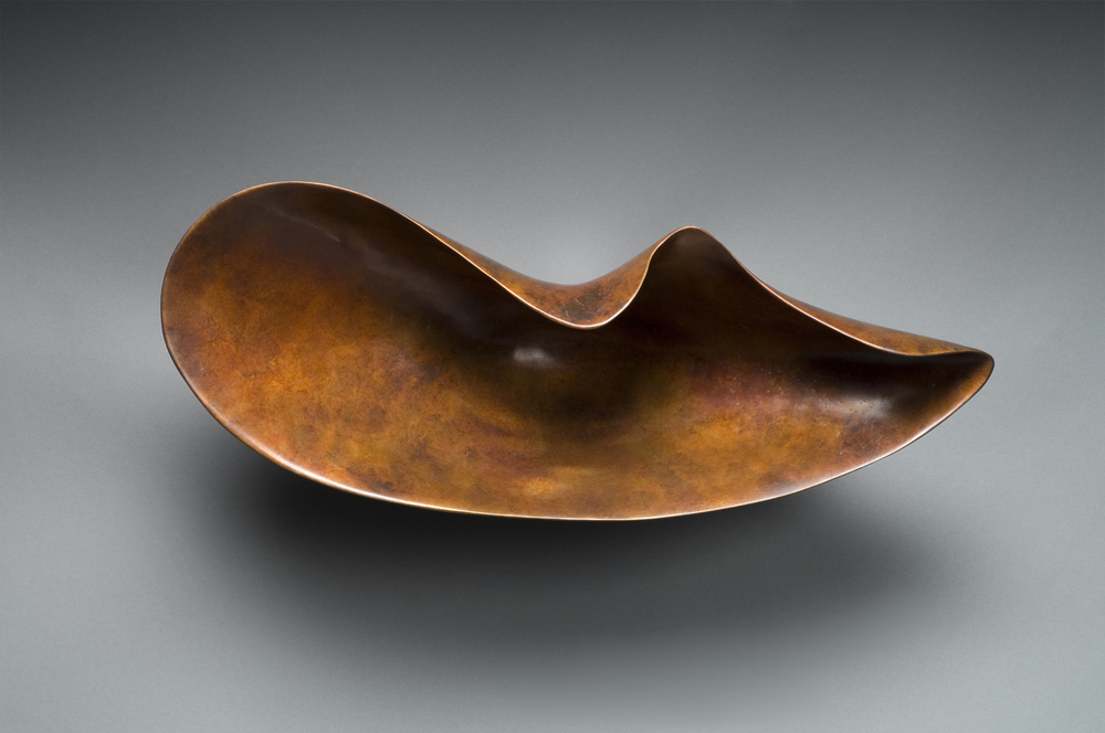 "BRONZE NAUTILUS    9""h x 21""w x 9""d    Cast bronze"