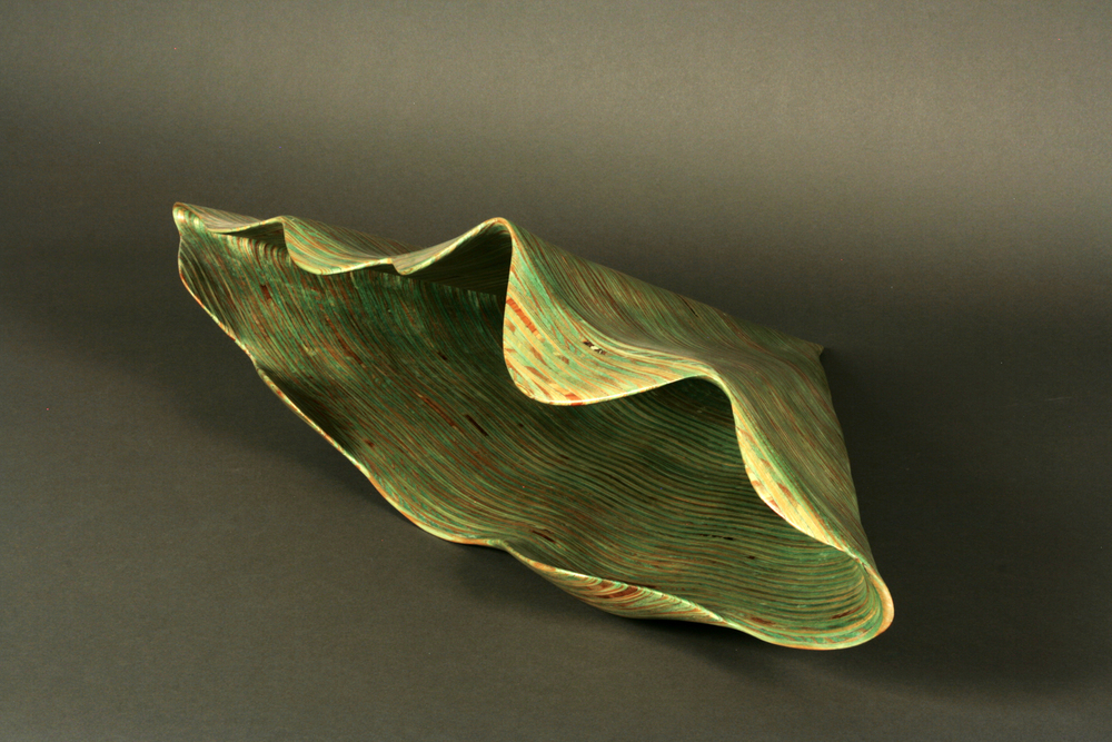 "SPRING: GREEN NAUTILUS     10""h x 34""w x 23""d     Laminated plywood, aniline dye"