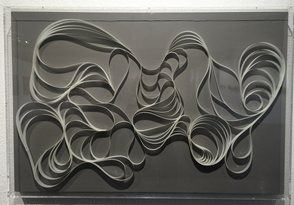"Wave  mylar, glue, monofilament  24"" x 36"" x 3.5"""