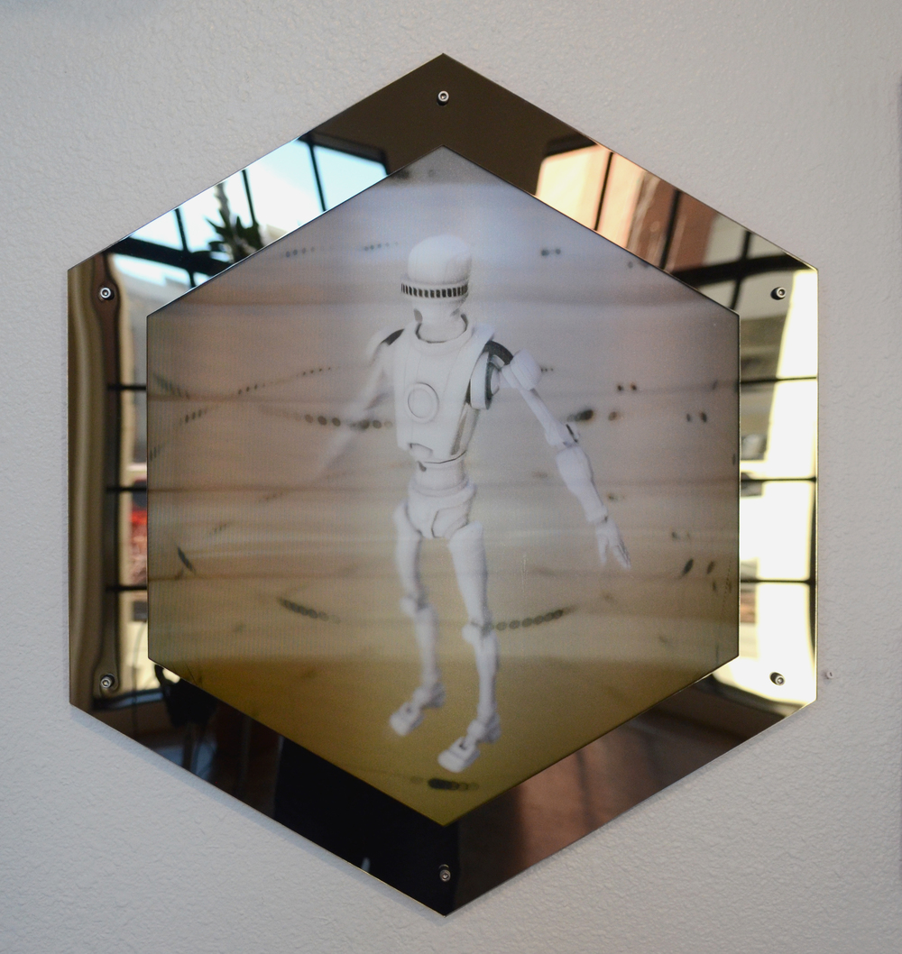 Robot (We were promised...)  lenticular print, bronze acrylic  25x30