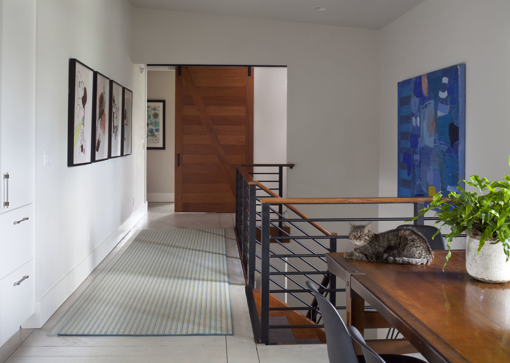 Private Residence. Design: C + A Interiors. Photography: Emily Minton Redfield. Artists: Angela Beloian (left), Eric Corrigan (right).