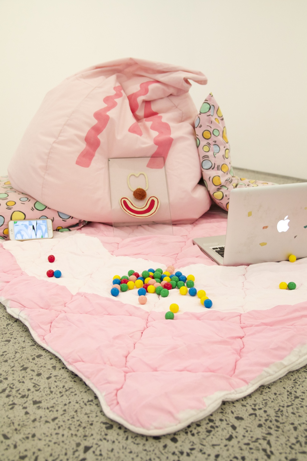 Rec Room (installation view)  Bean bag, laptop, Iphone, gum balls, glass, acrylic paint, pompom, bedding  dimensions variable  Photo: Isabel Rouch