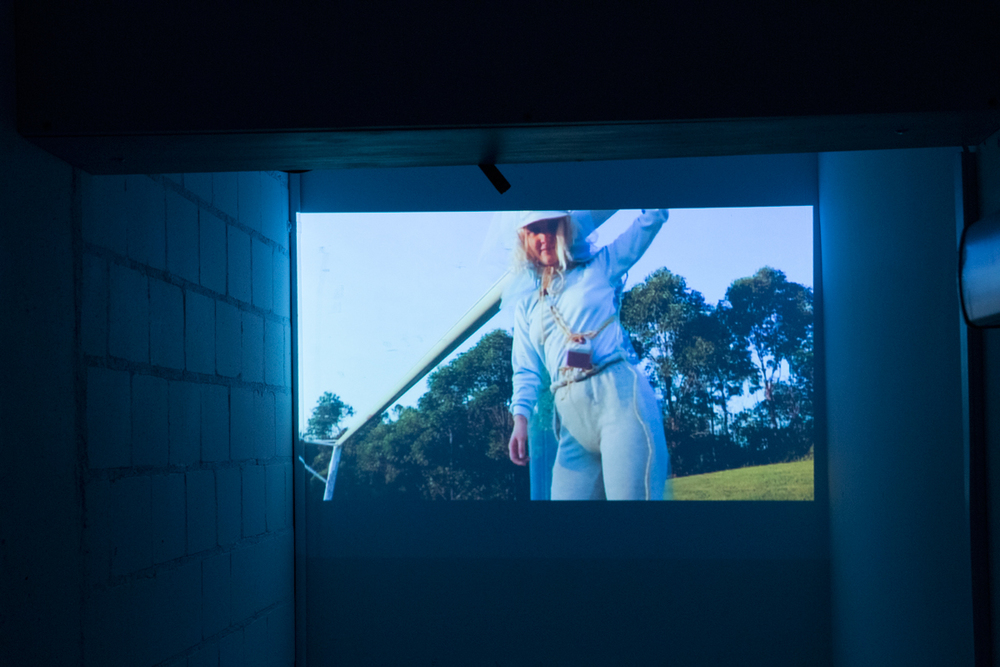 Clare Powell  Yours Truly, Soundcloud, 2016  Television monitor, Bluetooth speaker, projector, tulles, digital video, me, you  Video 1 (2 mins),Video 2 (5.30mins)  Curated by Hana Hoogedeure  Photo: Isabel Rouch