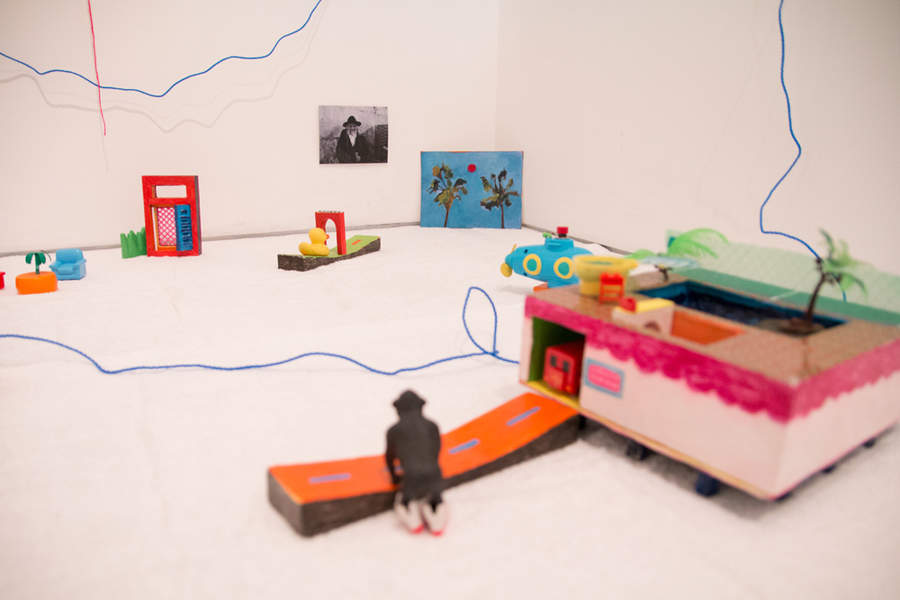Eko Bambang Wisnu  Leisure, 2016 (installation detail)  Painted ply wood, plastic toys, pencil sharpener, plasticine, latex, motors, battery, plastic rope, photograph, laminated stickers, office pins, mirror, knitting yarn, acrylic on Israeli vinyl banner, rat mesh, fly net, foam packing net, acrylic on canvas  2m x 2m x 2m  Curated by Hana Hoogedeure  Photo: Isabel Rouch