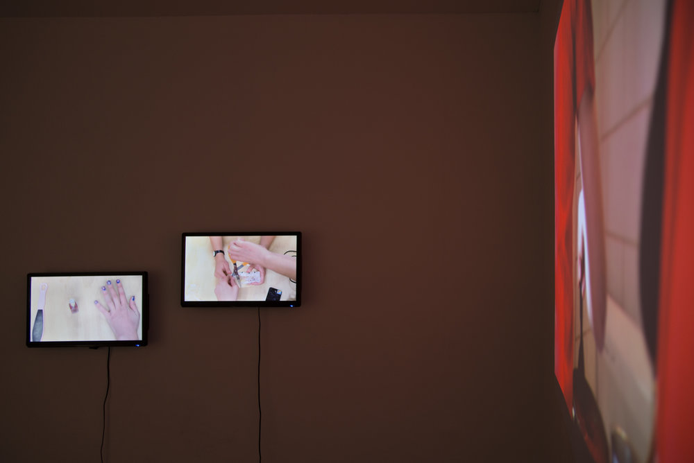 (Left)  On The Other Hand, 2016  2 x Digital HD Video (13.48mins)  (Right)  Progress, 2016  Digital HD Video (7.54mins)  Filmed by Sam Foster    Photo: Stephanie Fuller  Feltspace gallery