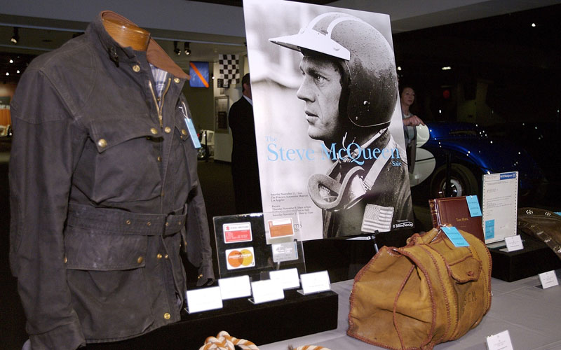A picture of the Steve McQueen Belstaff Trailmaster jacket shown on the left, it was auctioned by Bonhams in 2006 for $32,760. Picture published by motorcycle news. (I think that might be me to the left behind the sale poster)