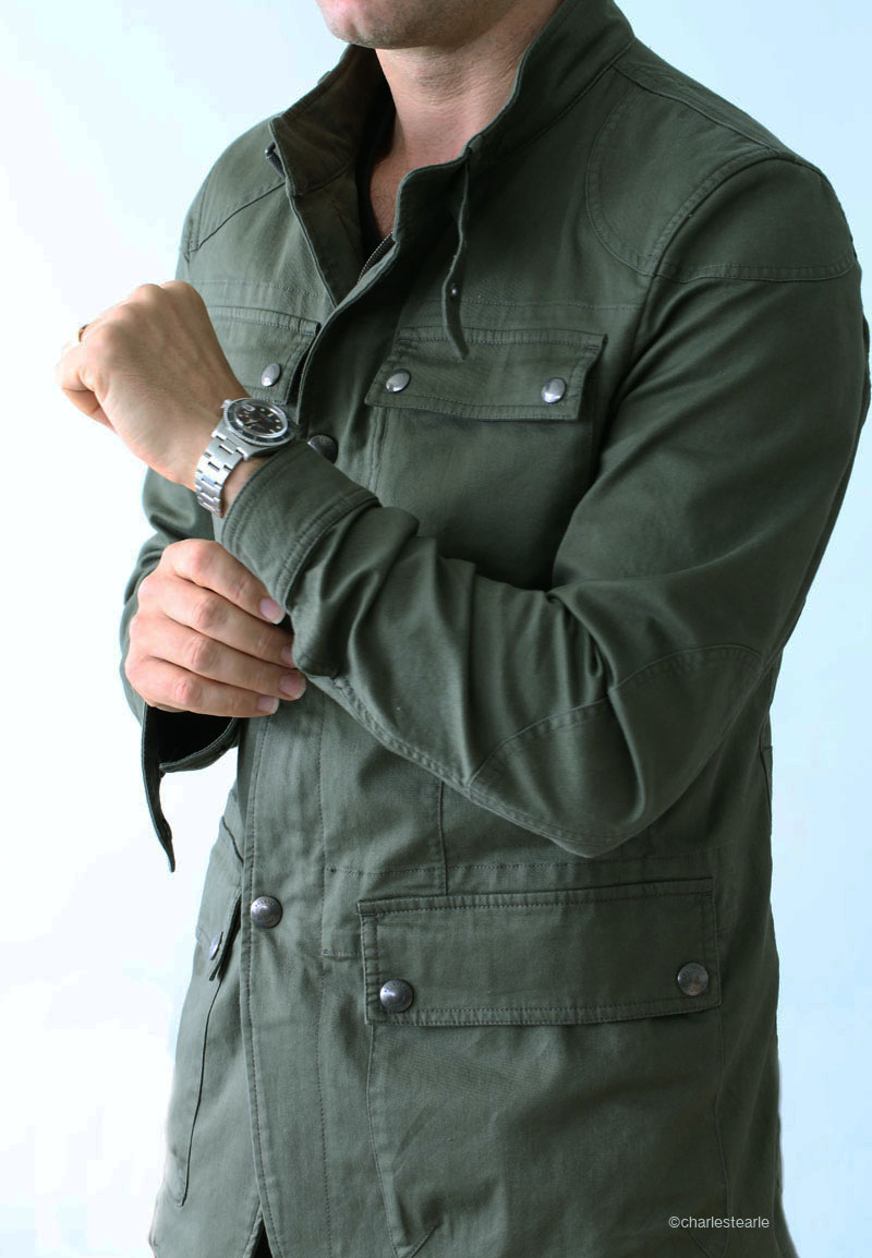 2014 Belstaff jacket worn with a 1973 Rolex 'red' Submariner Ref. 1680. The jacket is a lighter spring season retaining many aspects of the traditional version with buttoned cuffs and layered shoulders and elbows.