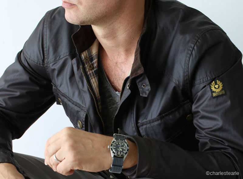 The classic Belstaff Trailmaster waxed cotton jacket in dark brown, worn with a 1956 Rolex Submariner Ref.6538 'James Bond. It doesn't get any more British.