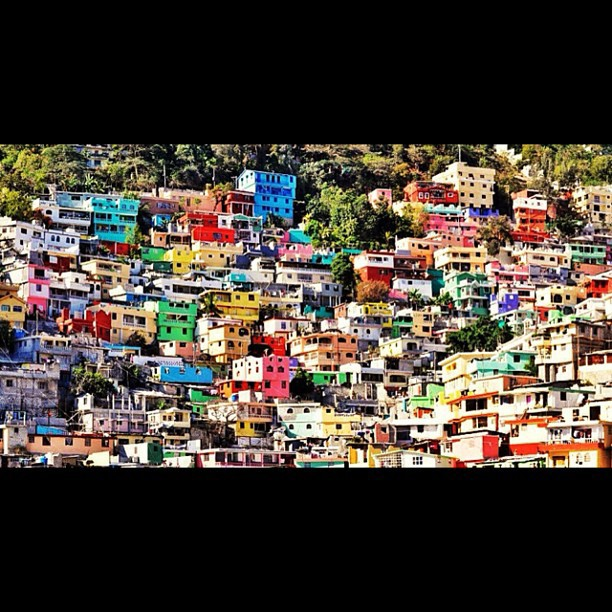 Can someone tell me where is it? #landscape #bidonville #colorful #architecture #Haiti