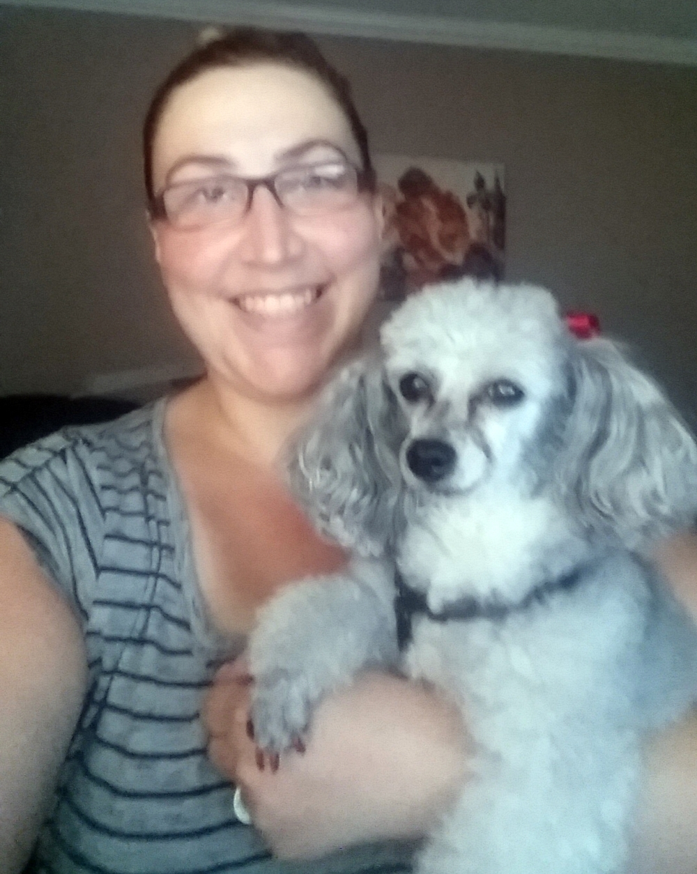 Here is Angela with one of her mother's poodle, Bella Note.