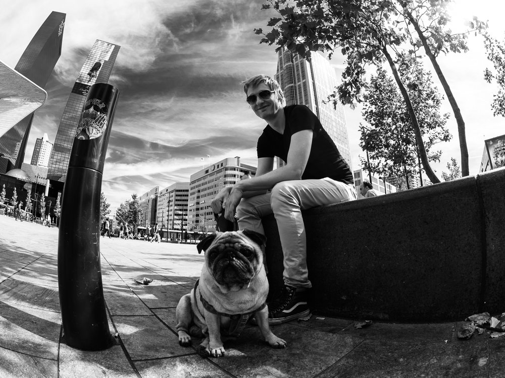 ROTTERDAM SEPTEMBER 2016  Shot taken at the Central Station in Rotterdam Centre.  Love to shoot street dogs. With the 8mm Fishye lens you get a lot of the environment in your shot.  Shot with Olympus OMD5 Mark 2 and Olympus 8 mm f/1.8 Fisheye PRO