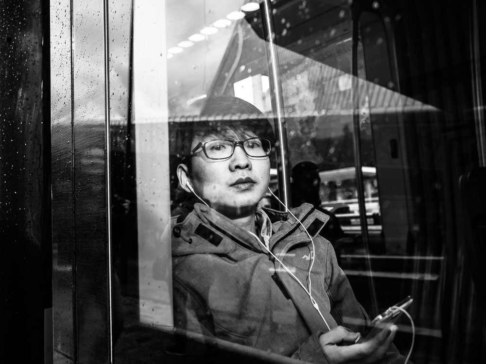 Shot taken at the Central Station. Endless possibilities to make photos of people behind glass. I guess this Glassy series will never end. Shot with Olympus OMD5 Mark 2 and Olympus 17mm f/1.8