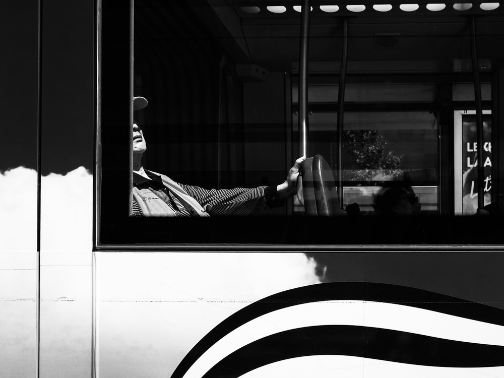 Photo taken in Rotterdam in June 2017. The minute he dived away from the window I knew that I had a new contribution to my Undercover series. I already had seen the lines on the tram that would complete this image.  Shot with Olympus OMD1 Mark 2 and Olympus 17mm f/1.8.