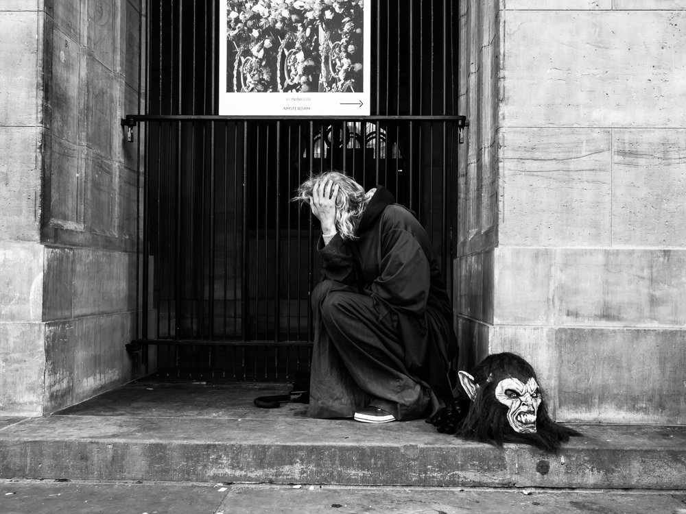 Photo taken in Amsterdam in September 2017. Due to bad personal circumstances I didn't get out much for street photography. The most pictures since May were taken during my workshops. Also this one. I like street artists most when they are  not  performing. This guy just has a break . I immediately recognised a contribution to my   Undercover series  . I consider this photo as one of my best of 2017.   Shot with Olympus OMD1 Mark 2 and Olympus 17mm f/1.8.