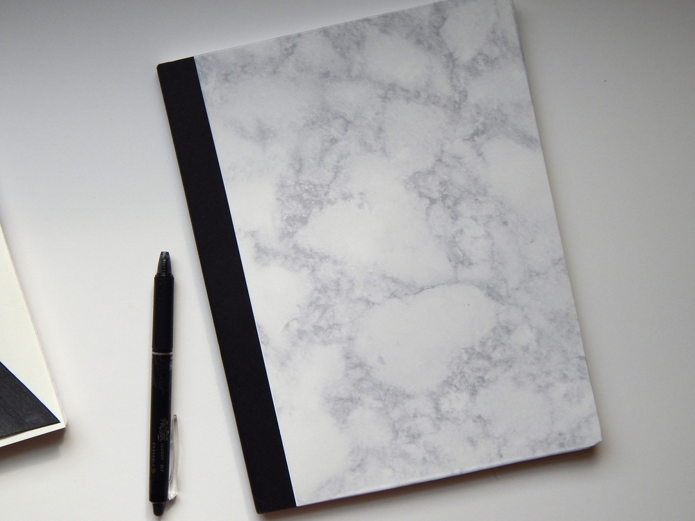 This is probably my favorite one I made and the easiest. All I used was Marble Contact Paper from Lowes. It was around $10, but I can seriously make like 100 notebooks from it. And other school supplies too! I didn't need to use glue or anything because the contact paper has super strong adhesive already.