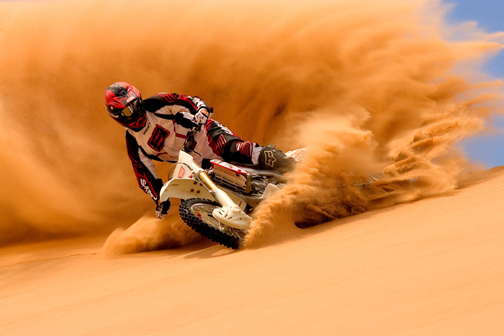 Rich's passion for two wheels is inherent from his father Richard Van Every Sr. After racing mountain bikes at a pro level, he began filming motocross full time and fell in love with riding in the mountains and deserts. This images was captured by his friend Jason Ford at the Glamis Sand Dunes in southern california.