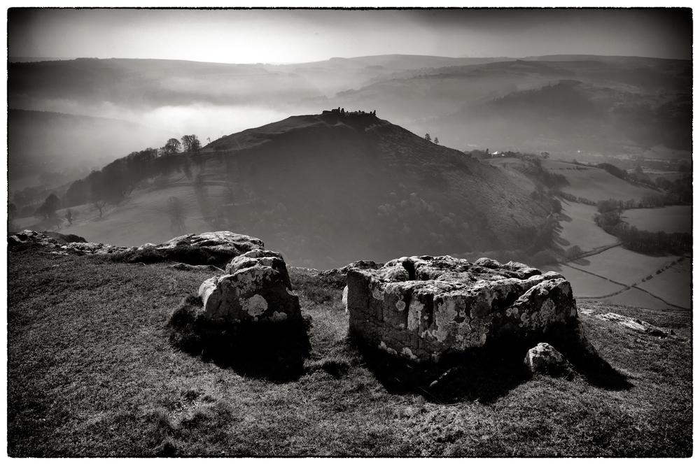 Dinas Bran silhouetted through the mist.