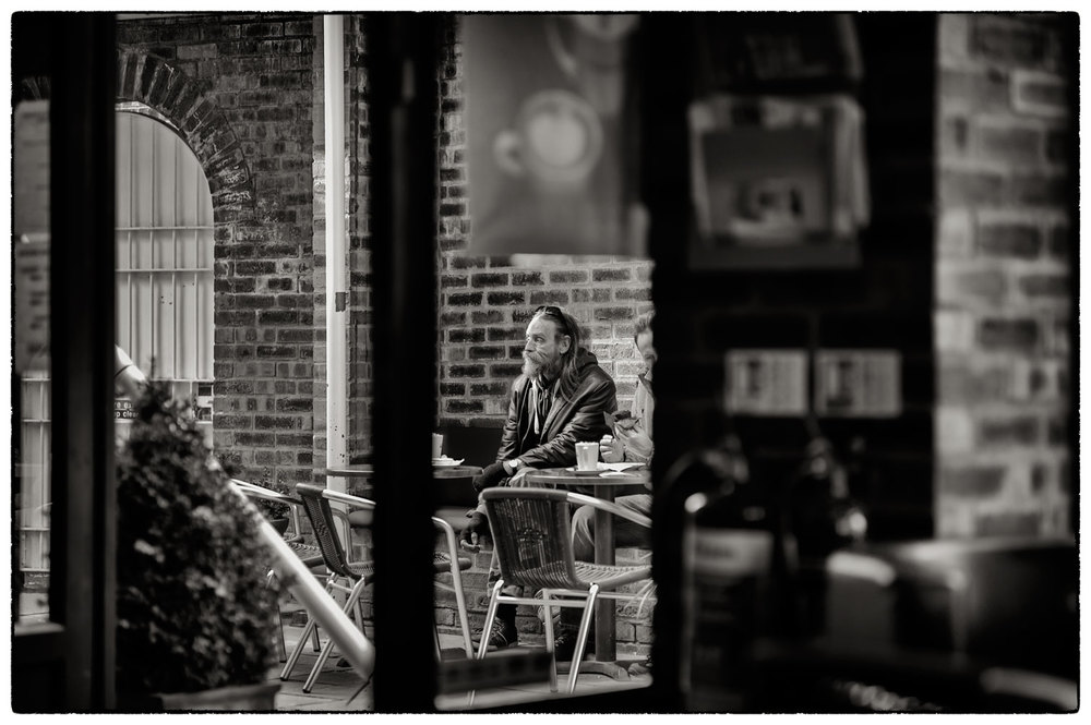 In the coffee shop, people watching.