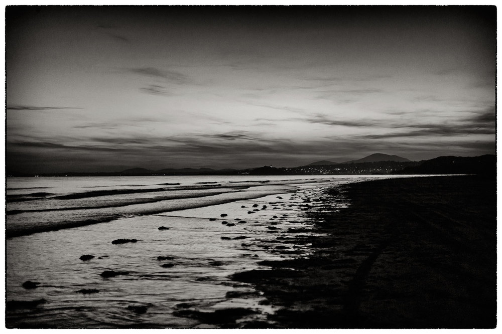 Beach after sunset looking towards Criccieth from Porthmadog.