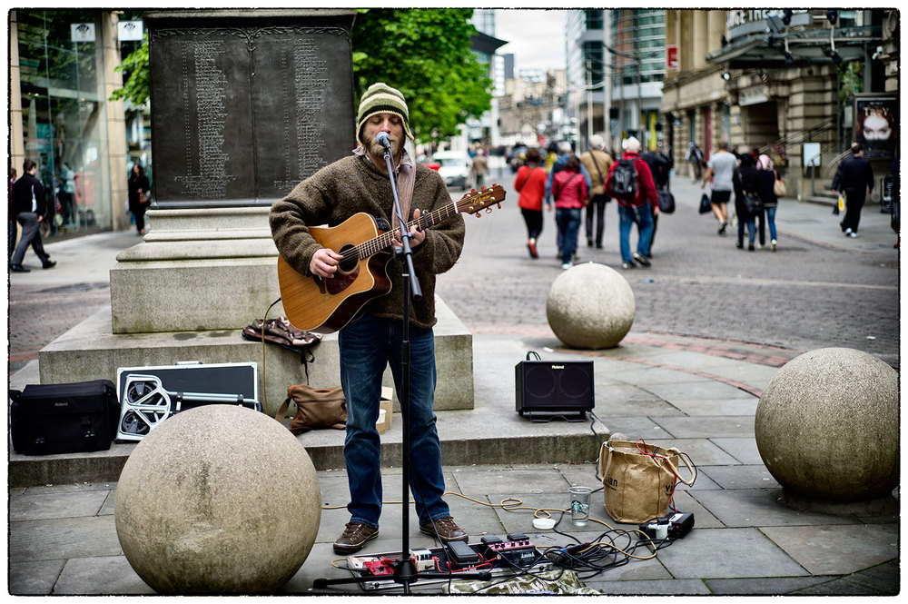 Busker in St Anne's Square, Manchester.