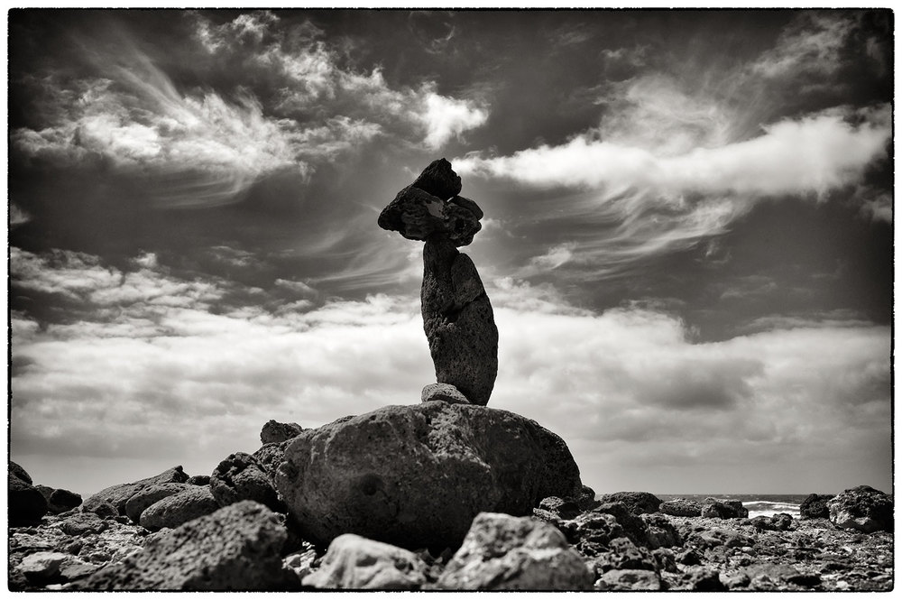 Balanced stones at Faro de Toston, with the Atlantic behind.