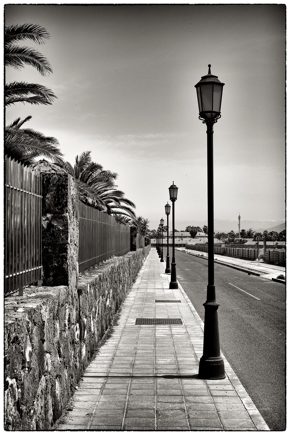 Lamp posts all in a row as far as the eye can see, Corralejo.